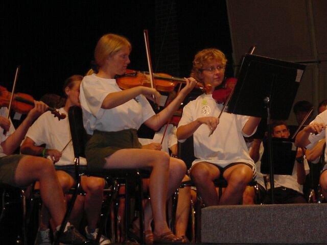 Violins Section, some with sunburned legs